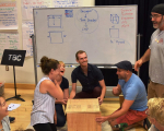 Opera Creation Boot Camp teacher participants use math to build a scenic show cube.