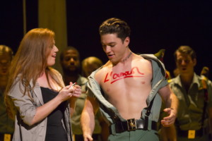 "Carmen (Jennifer Johnson Cano) scrawls ""love"" on the chest of solider Joseph Yonaitis in Boston Lyric Opera's production of Georges Bizet's ""Carmen"" directed by Calixto Bieito. ""Carmen"" opens BLO's 40th Season, at the Boston Opera House through October 2. Photo: T. Charles Erickson"