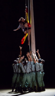 "A town woman is hoisted up a flagpole by a group of unruly soldiers in Boston Lyric Opera's production of Georges Bizet's ""Carmen"" directed by Calixto Bieito. ""Carmen"" opens BLO's 40th Season, at the Boston Opera House through October 2. Photo: T. Charles Erickson"