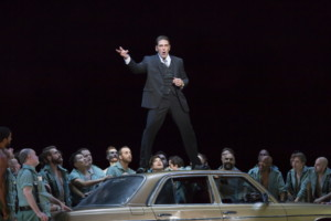 """The dashing matador Escamillo (Michae Mayes) delights the men of the town with boastful stories about his exploits in the bullring -- and outside it -- in Boston Lyric Opera's production of Georges Bizet's """"Carmen"""" directed by Calixto Bieito. """"Carmen"""" opens BLO's 40th Season, at the Boston Opera House through October 2. Photo: T. Charles Erickson"""