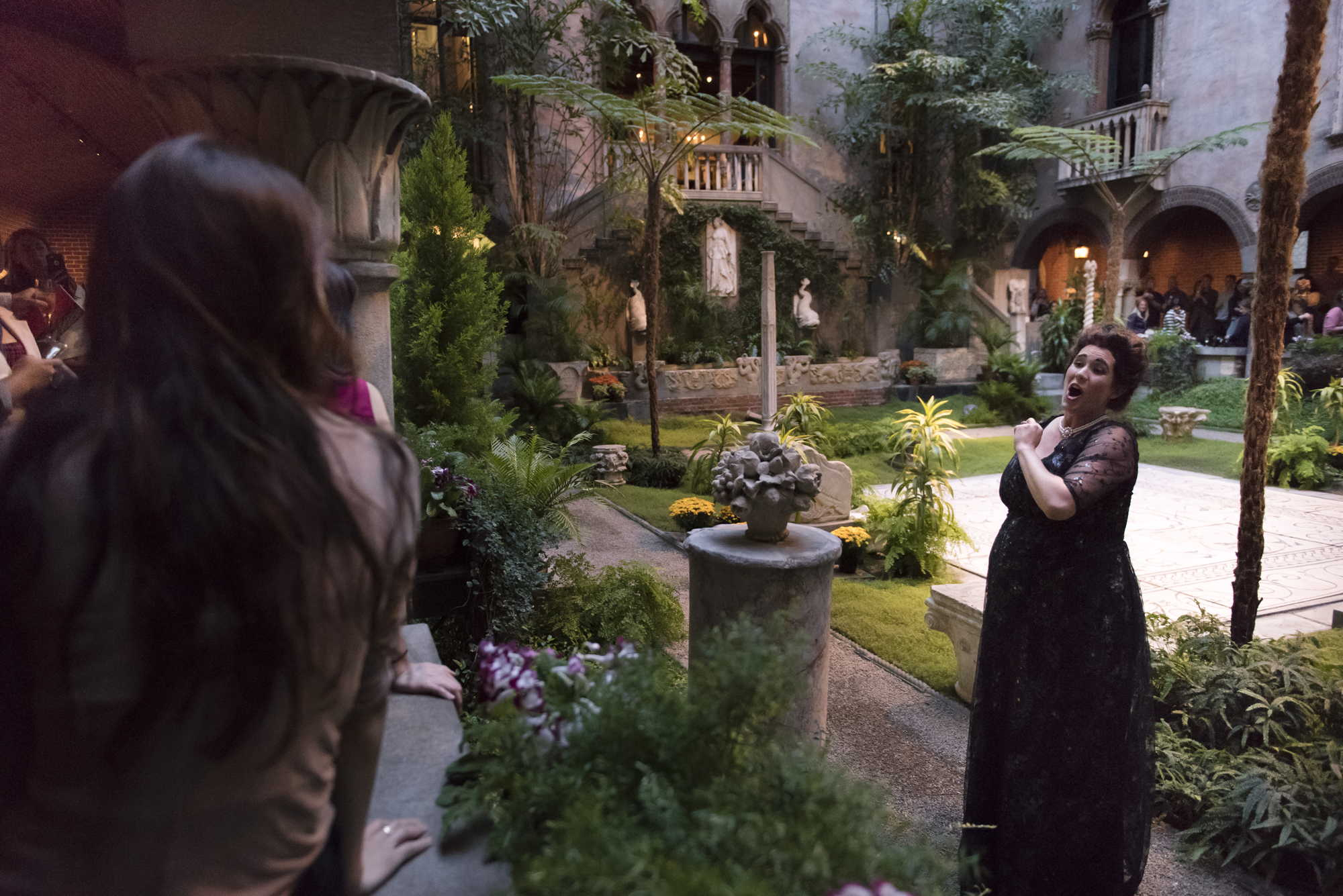 Soprano Chelsea Basler, dressed as the famous historical singer Nellie Melba, serenades the crowd at the Isabella Stewart Gardner Museum's Third Thursday series. photo by Liza Voll Photography.