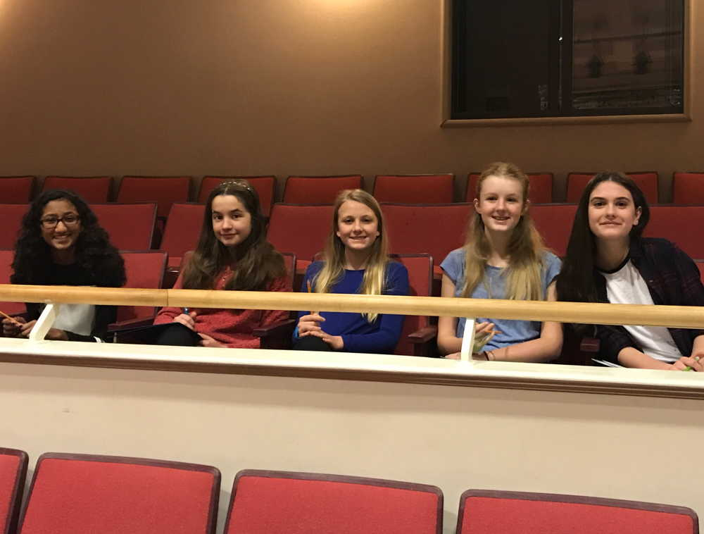 Five young women sit in theater seats smiling, as part of BLO's Middle School Audition Workshop in partnership with VOICES Boston.