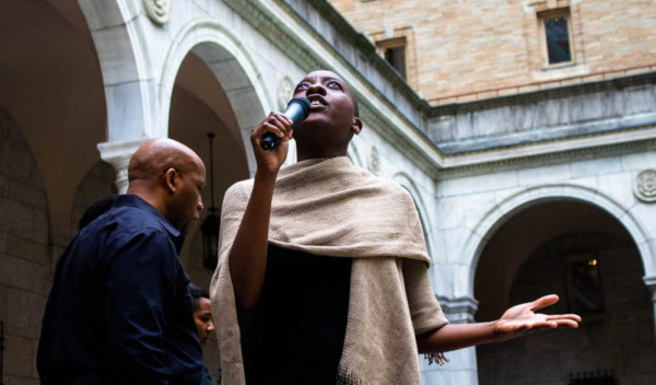 Spoken word artist Adobuere Ebiama performs during Crossing the Line to Freedom: A Musical Narrative in the Boston Public Library's courtyard. photo by Todd McNeel