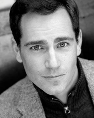Matthew Worth as Figaro, THE BARBER OF SEVILLE, Boston Lyric Opera, 2018