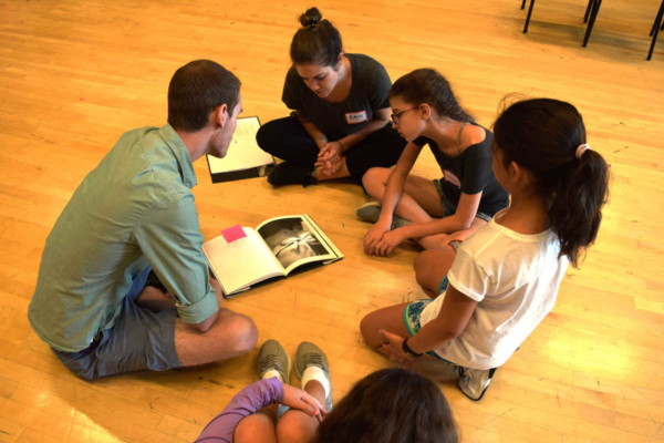 Students and teaching artist Eric Ritter discuss inspiration images for their original opera during BLO's summer Opera Creation Boot Camp. Photo: BLO staff